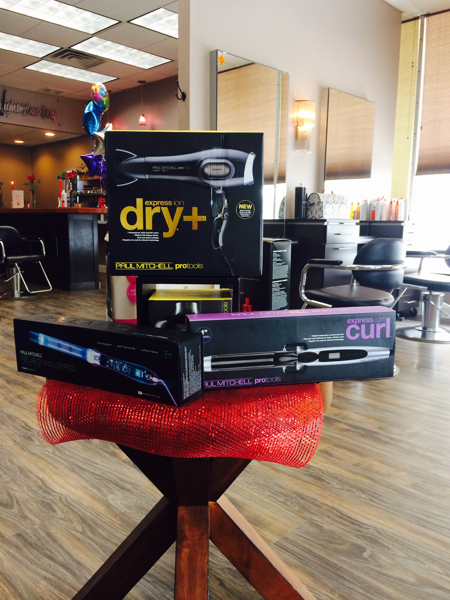 Hair Dryer, Neuro Unclipped, and Express Ion Curl Curling Iron - get yours now at The Colorist Salon in Cleveland, OH